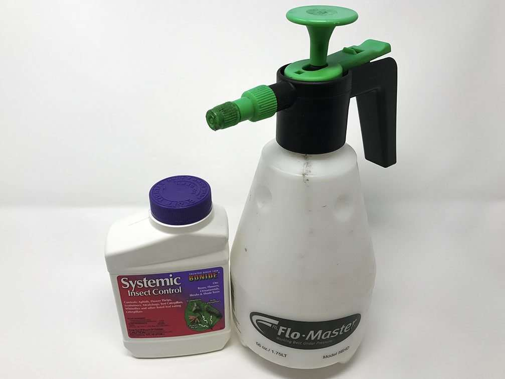 systemic pesticide and spray bottle